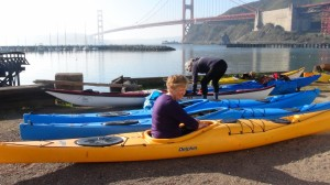 Michelle adjusts and fits the kayak she will use for the next 5 days